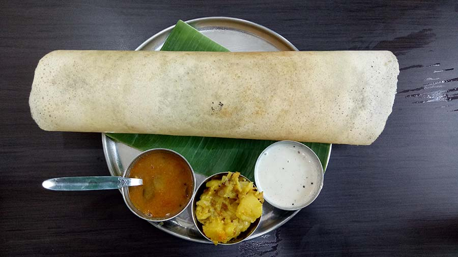 MASALA BUTTER DOSA FROM BANANA LEAF: Want to eat out and need to stick to a vegetarian menu? Try a dosa with sambar and coconut chutney this Ashtami from the Lake Market, Vivekananda Park or New Town outlets.