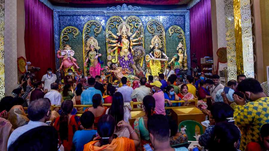 Devotees at a community Durga Puja, in Calcutta on Wednesday.