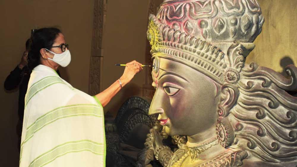 Mamata Banerjee inaugurating a puja.