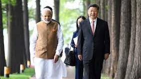 Narendra Modi (left) and Xi Jinping in Wuhan in April 2018.