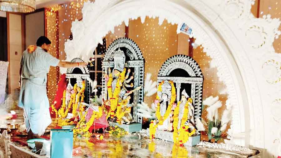 A priest conducts rituals at the Dubai puja