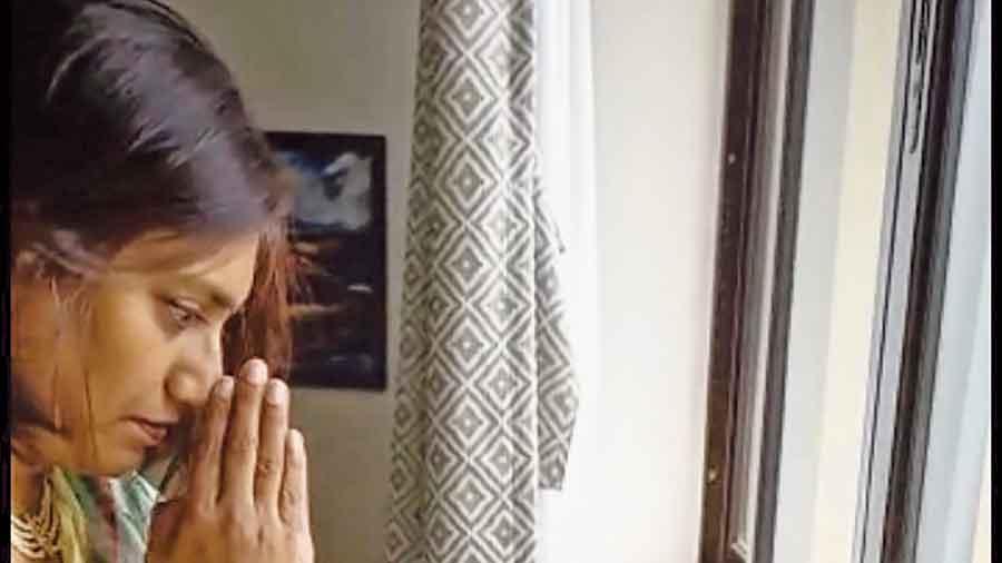 Avantika Mallik, one of the organisers of Bombay Durgabari Samiti puja,  offers anjali virtually