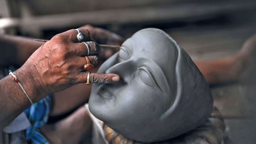 The clay sculptors bring mud and straw to life in the winding lanes of Kumartuli.