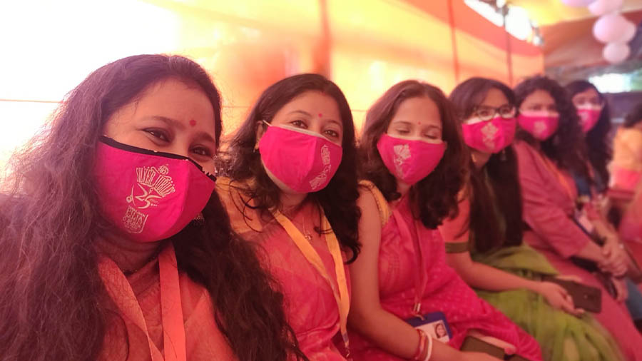 Residents pose with the customised mask