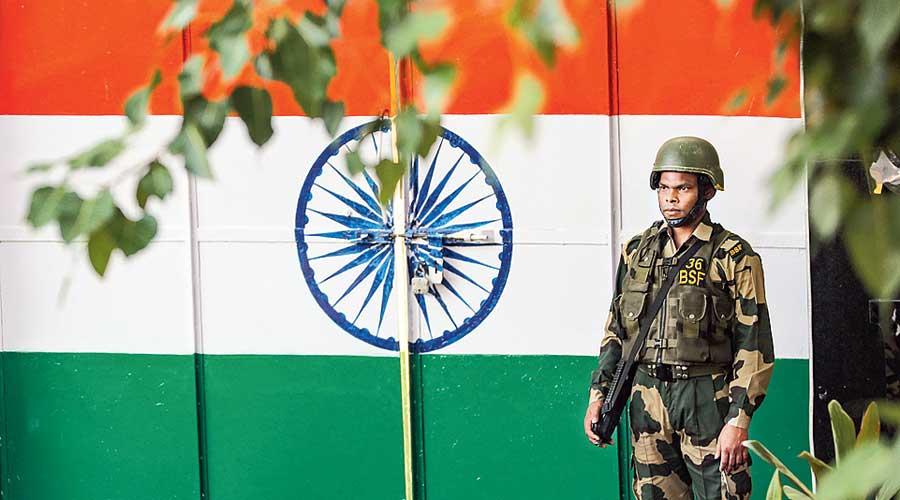 A BSF jawan stands guard  at Jammu border earlier  this month.