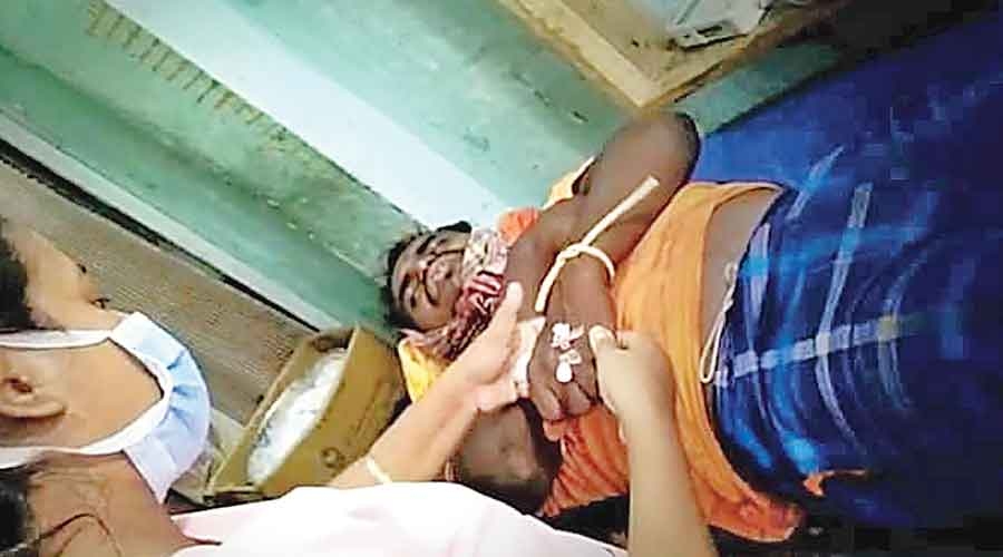 Injured fisherman Sudarshan Sarkar being treated at Gosaba on Thursday morning. He was later referred to NRS in Calcutta.