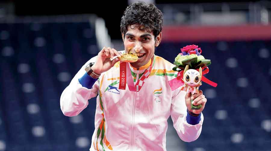 Gold medallist Pramod Bhagat on the podium after winning the men's badminton  singles SL3 at the Tokyo 2020 Paralympic Games on Saturday.