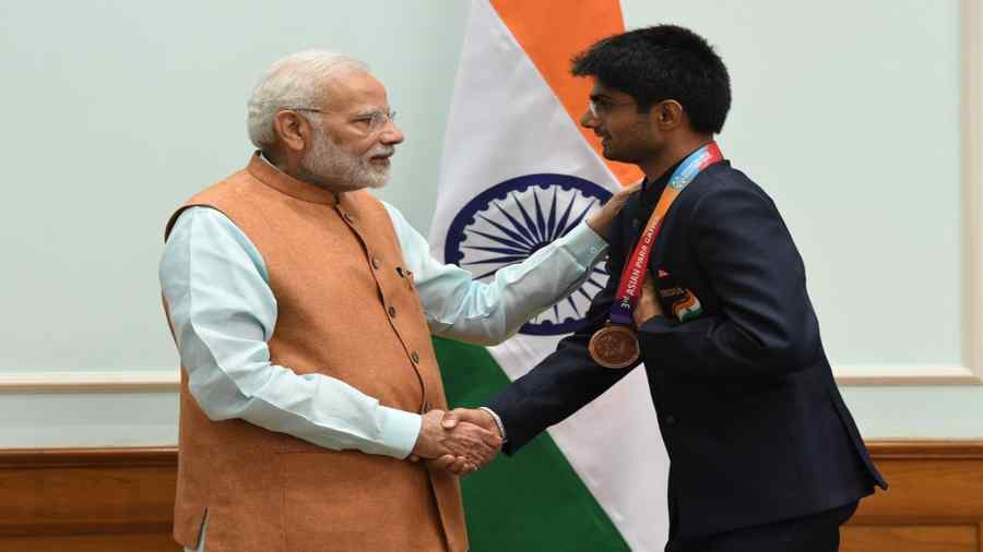 PM Modi with Suhas Yathiraj.