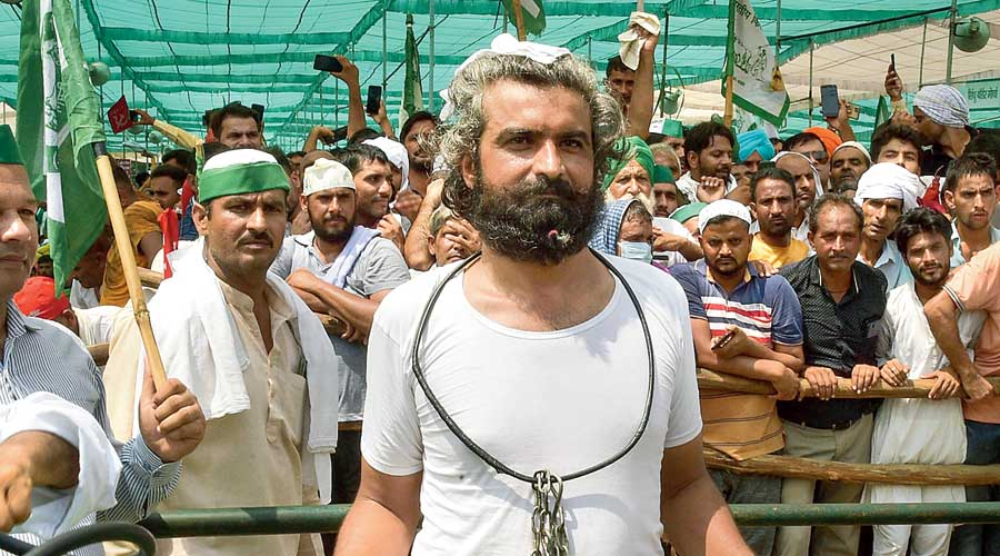 A farmer dressed as a prisoner at the mahapanchayat in the Uttar Pradesh district  on Sunday