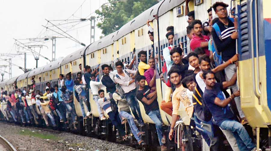 Passengers, flouting Covid-appropriate behaviour, travel in an overcrowded train in Patna on Monday amid the ongoing coronavirus pandemic