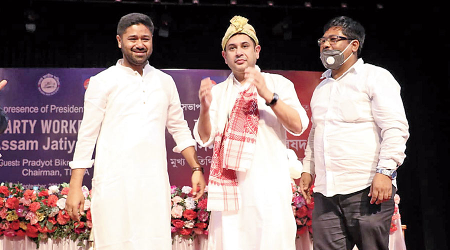 AJP president Lurinjyoti Gogoi (left) with TIPRA chief Pradyot Kishore Manikya Debbarma (centre) at the AJP party workers' meet in Guwahati on Tuesday