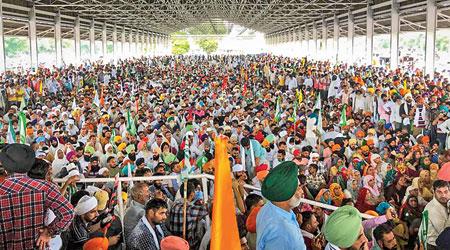 Farmers attend the mahapanchayat in Karnal on Tuesday.