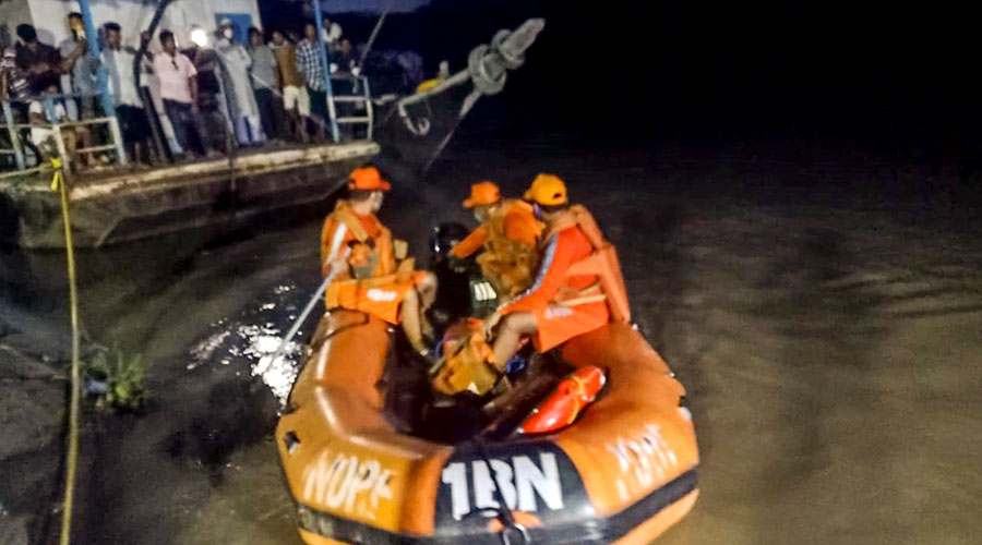 NDRF personnel carry out rescue work after two boats capsized near Nimati Ghat following a head-on collision, in Jorhat on Wednesday.