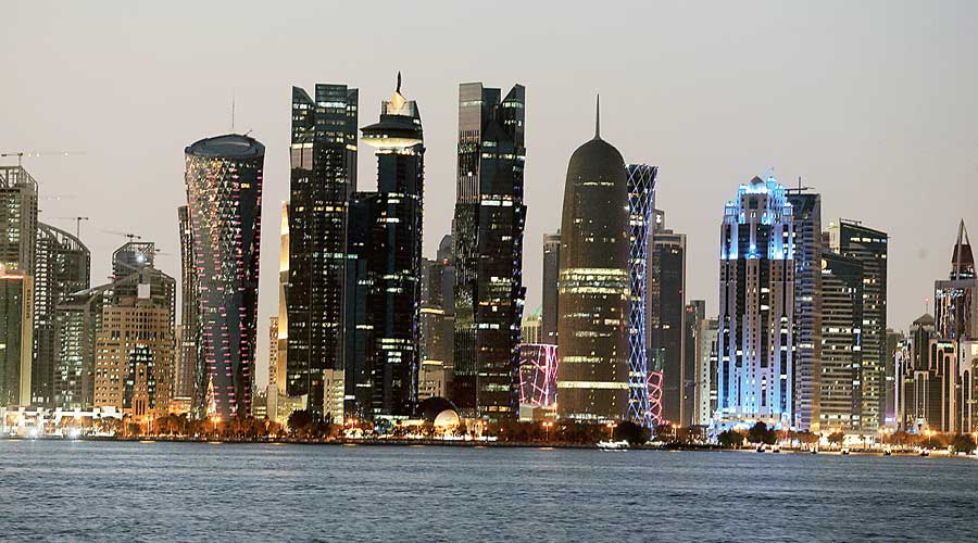 The buildings of Doha's business district at sunset.