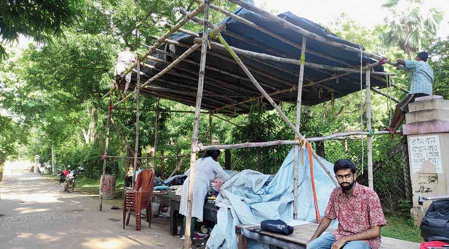 The pandal at the students' protest site in Santiniketan being dismantled on Thursday.
