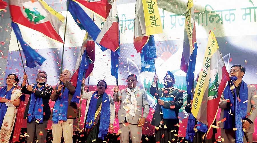 Leaders wave flags of the Bhartiya Gorkha Prajatantrik Morcha during its launch in Darjeeling on Thursday.