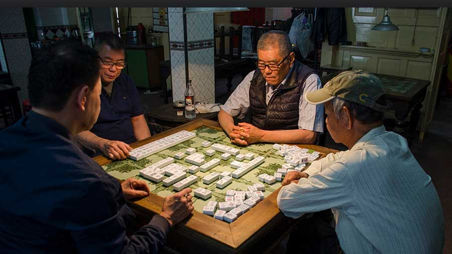 A game of Mahjong in Gee Hing Church