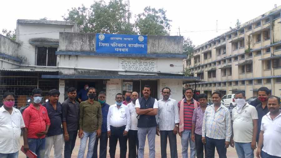 Leaders of Dhanbad Auto Unions outside the DTO office in Dhanbad on Monday.