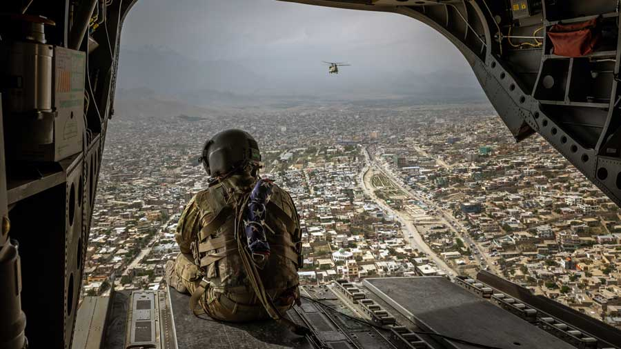 An American soldier on a CH-47 Chinook helicopter flying over Kabul, Afghanistan's capital, on May 2, 2021.