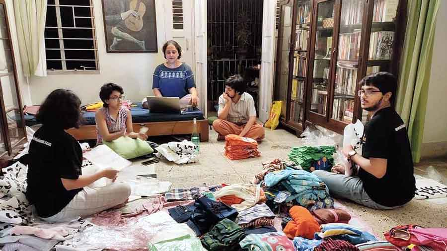 Clothes being sorted at the home of one of the members of the organisation in Patuli