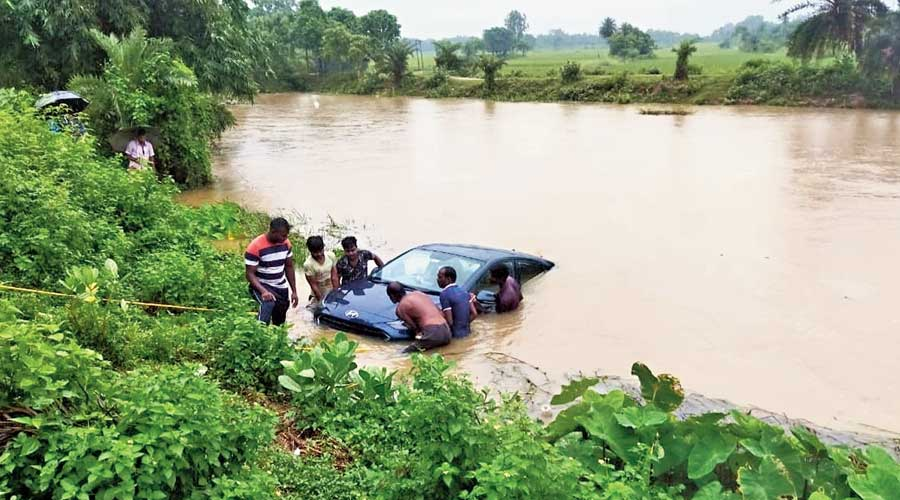 A car in an overflowing pond at West Midnapore's Keshpur on Wednesday