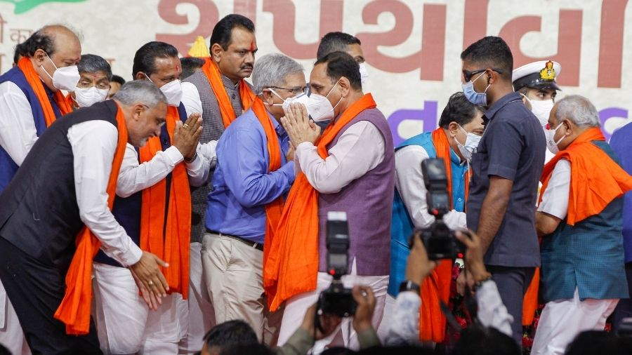 Newly sworn in ministers greet former Gujarat CM Vijay Rupani after oath-taking ceremony on Thursday in Ahmedabad