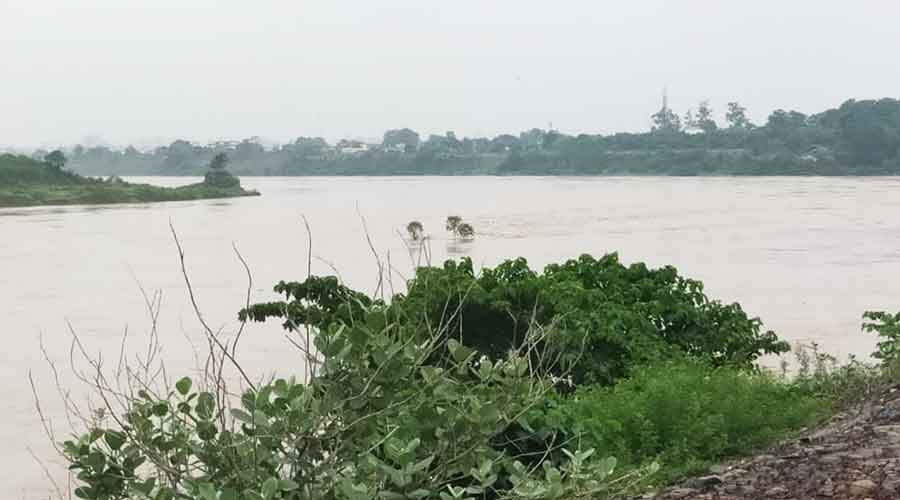 Kharkai river which passes through Jamshedpur in spate on Thursday.