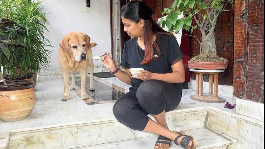 Amrita Das offering Zero a spoonful of curd.