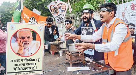 Youth Congress members protest against unemployment in Bhopal on Prime Minister Narendra Modi's birthday on Friday.