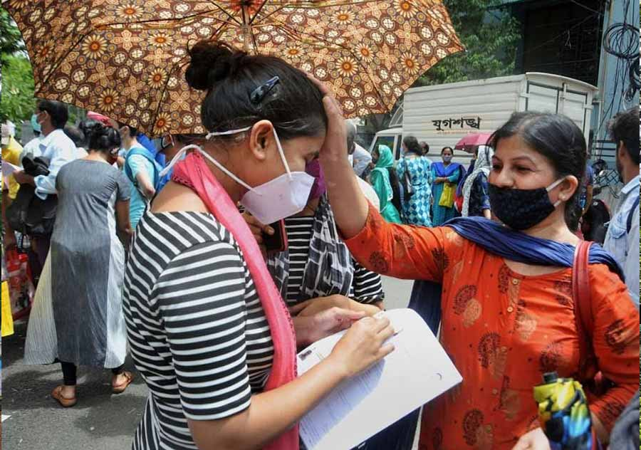 MOTHER'S BLESSINGS: Outside a NEET exam centre in Kolkata on Sunday, September 12. A record 16.14 lakh students registered this year for the National Eligibility cum Entrance Test for admission into medical colleges across the country