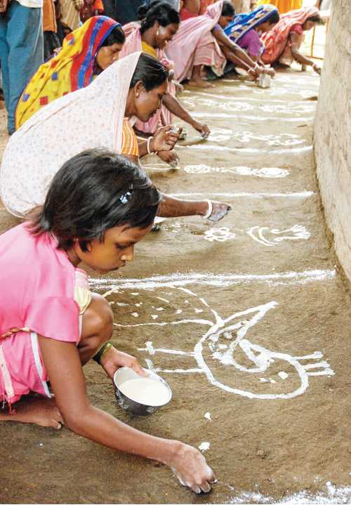 Alpana being drawn on the occasion of hal divas