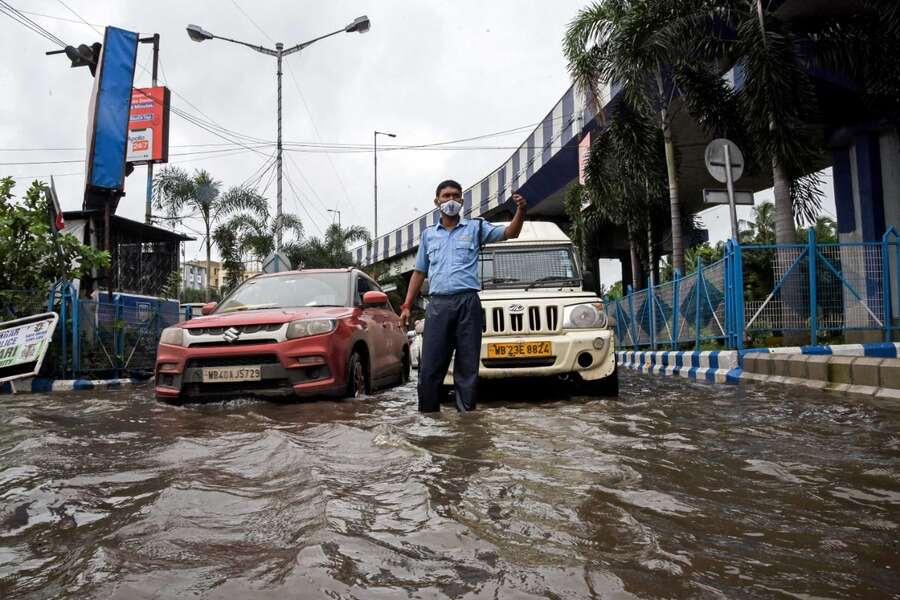 VIP Road on Tuesday morning. Kolkata woke up to slightly less cloudy skies a day after it was battered by record rain sparked by three monster weather systems — two cyclonic circulations and the monsoon trough — ganging up in the skies above it