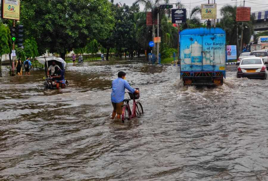 """A stretch of VIP Road under water on Tuesday morning. """"Despite the rains having stopped hours ago, there is no difference in the flooding in our area,"""" Parthiv Bhattacharya, 22, who lives near Tollygunge, told My Kolkata. """"Many people have seen water seep into their garages and cars, and I myself had to use bricks to keep my car above water. Besides this, we still have no electricity, and connectivity is a major problem."""""""