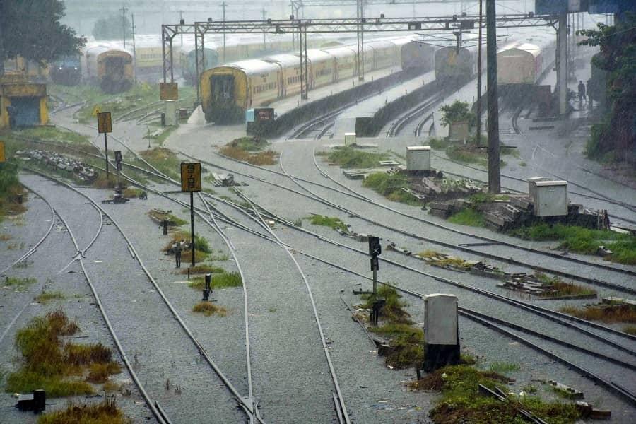 Waterlogged railway tracks due to heavy rain, near Tikiapara Railway Station in Howrah district.