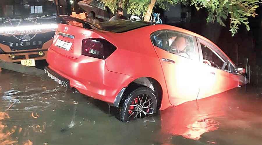 Road-pond divide blurs, car sinks off Bypass