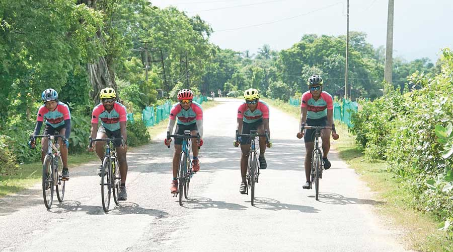 (L -R) Abhishek, Pratap, Vicky, Sunny and Shakti cycle through the Odisha countryside at the end of Day Three
