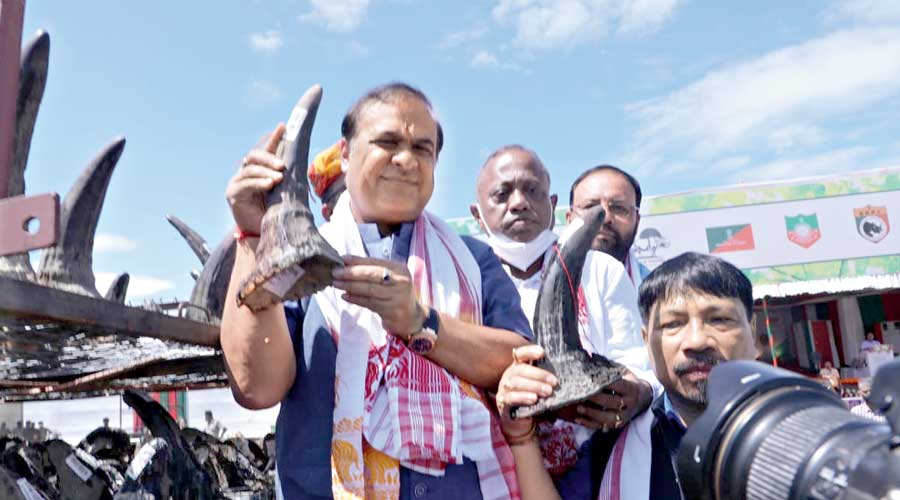 Assam chief minister Himanta Biswa Sarma (left) with a rhino horn