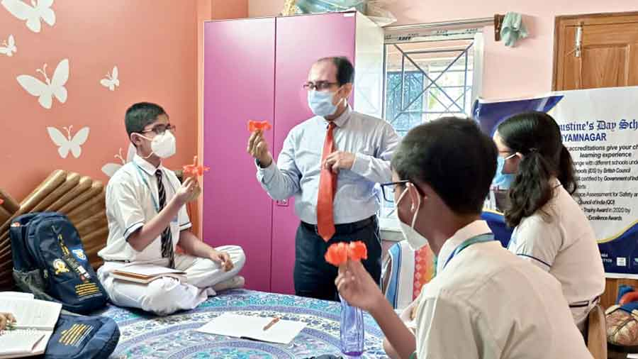 Students of St Augustine's Day School, Shyamnagar,  conduct experiments at home
