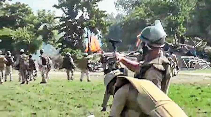 Police try to disperse the protesters in Darrang.