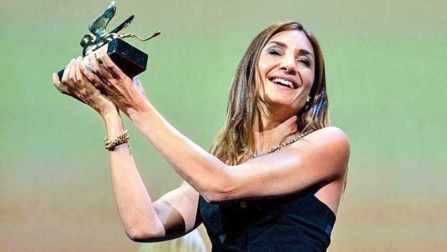 Audrey Diwan poses with the Golden Lion for Best Film for L'Evenement (Happening) at the 78th Venice Film Festival earlier this month