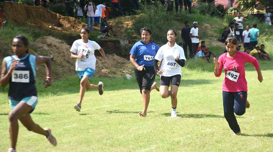 Participants take part in the 100 mt race for girls.