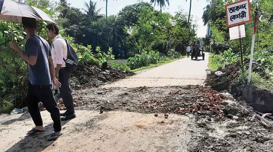 A road leading to Akanda Keshori village, near New Town Action Area III, has been dug up to drain out water faster.