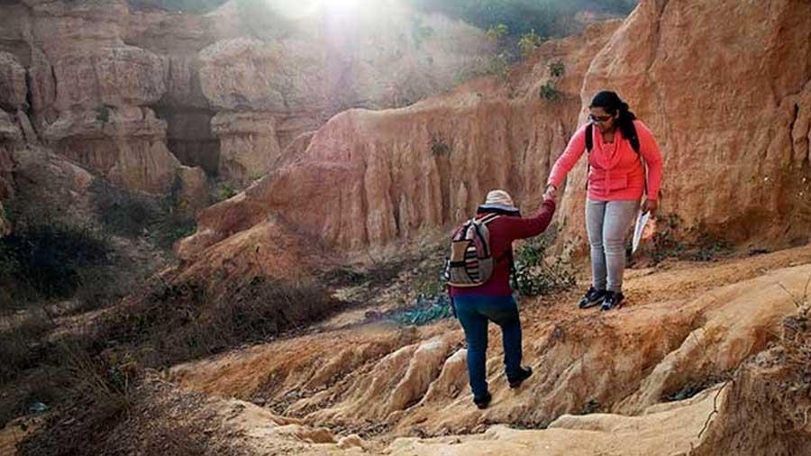 Tourists on a trail inside the canyon.
