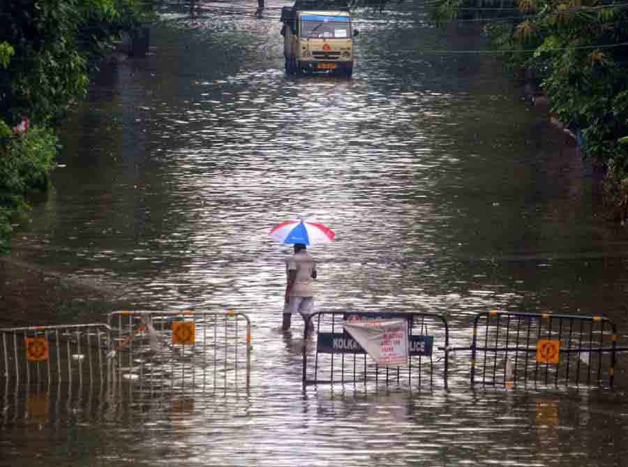 WATER WORLD: A stretch at Taratala in south Kolkata on Monday, September 20. Three weather systems — the monsoon trough and two cyclonic circulations — collided over the Kolkata skies to trigger the highest rain Kolkata has seen in September in a while. It sparked traffic snarls, power outages, and even deaths from electrocution.