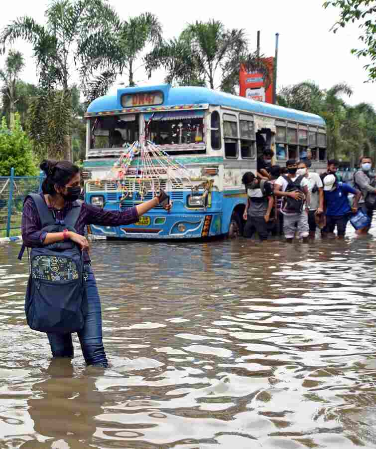 WOE FRAME: A woman takes a selfie on a flooded stretch in the New Town area on Tuesday, September 21. The torrential downpour that began on Sunday night left many vital arteries of the city waterlogged. Salt Lake, New Town and areas in south Kolkata were the worst hit.
