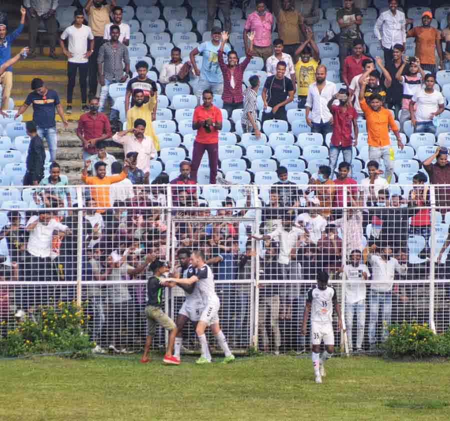 FANS RETURN: A spectator rushes into the ground after Mohammedan Sporting Club scored against Gokulam Kerala during the first quarter final of the Durand Cup at Salt Lake stadium on Friday, September 24. Around 10,000 fans watched the match, a first since the pandemic
