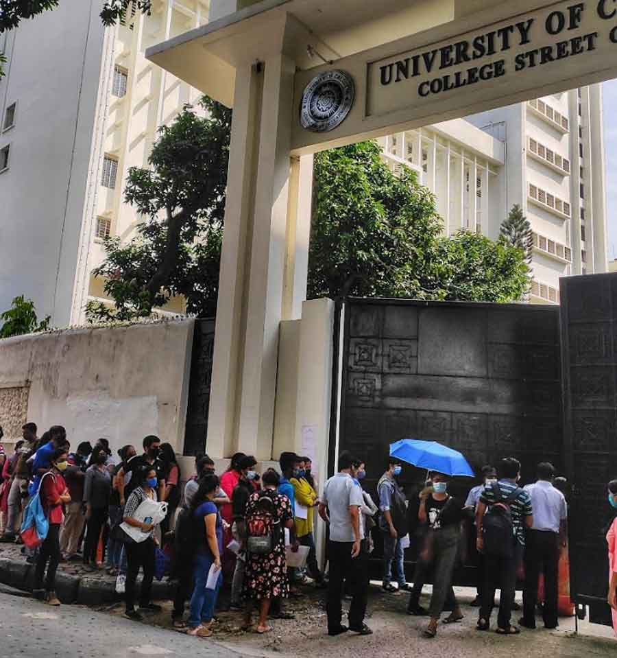 RITE OF PASSAGE: Students queue up to collect their migration certificates at the gates of the Calcutta University on Friday, September 24