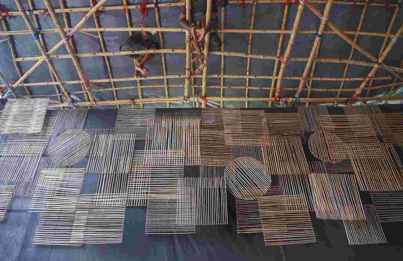 THAT TIME OF THE YEAR: Artisans weave the ceiling of a Durga Puja pandal from cane in Kolkata on Saturday, September 25. The one worry for the city this year is whether the later-than-usual rains will play spoilsport on Puja days