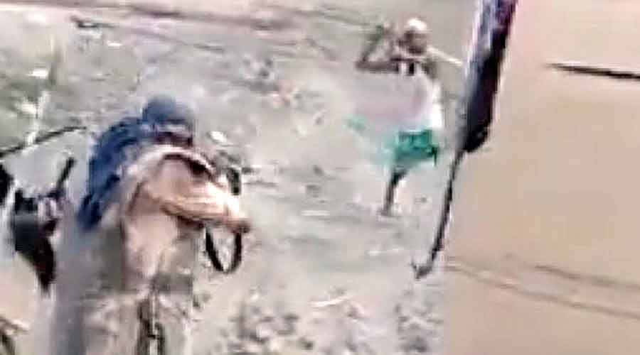 Footage shows a policeman taking aim at Hoque.