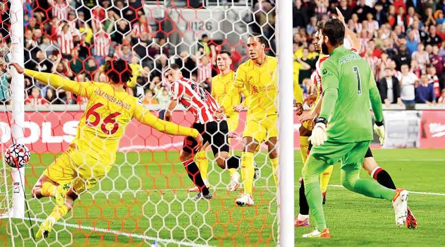 Vitaly Janelt scores Brentford's second goal against Liverpool on Saturday.